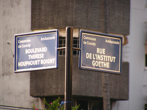 Street signs at a crossroads in Abidjan - Photo by Flickr user abdallahh under CC-BY 2.0 license